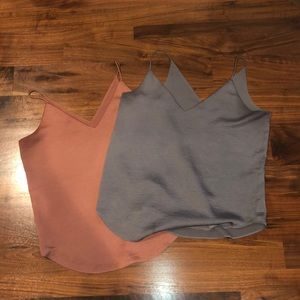 Two silver and rose gold express tank tops.